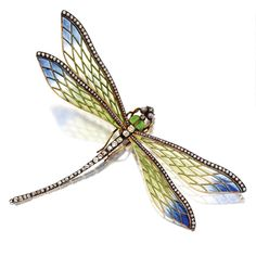 ART NOUVEAU PLIQUE-À-JOUR ENAMEL AND DIAMOND DRAGONFLY BROOCH, FRENCH, CIRCA 1900, Mounted en tremblant, the wings of green and blue plique-à-jour enamel edged in rose-cut diamonds, the body decorated with old-mine diamonds and apple green translucent enamel, the eyes set with 2 pinkish-gray pearls, mounted in gold and silver, maker's mark GA for Georges Auger, assay marks.