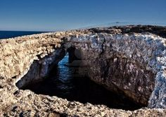 """A massive crater or """"blow hole"""" cave located at l-Ahrax in Mellieha in Malta."""