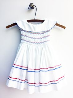 A personal favorite from my Etsy shop https://www.etsy.com/listing/250881107/vintage-girls-dress-white-polly-flinders