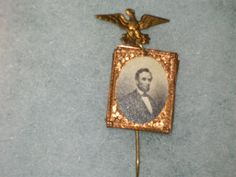 "Lincoln Campaign Pin.  Eagle with Lincoln below.  Nice image of bearded Lincoln.  Image is about 1"" square.  With original stickpin.  Relics"