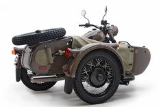 Ural M70.  I'd put one of the dogs in the side car with their doggles on.  :)