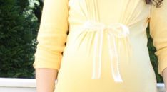 Make just about any shirt into a maternity top, super simple! Would be cute with a buckle too!