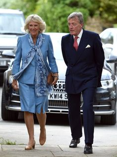 Camilla, Duchess of Cornwall (L) is met by the Lord-Lieutenant of Oxfordshire Tim Stevenson as she arrives at St Martin's Church to unveil a stain glassed window to commemorate the 50th anniversary of the death of Sir Winston Churchill on June 9, 2015 in Oxfordshire, England.