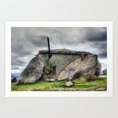 "Stone house in Fafe, Portugal Art Print by Vitor Ribeiro - $12.48 Located in the Fafe mountains of northern Portugal, A Casa do Penedo, or ""the House of Stone,"" was built between four large boulders found on the site. Although the house may seem rustic, it is not lacking in amenities, which include a fireplace and a swimming pool--carved out of one of the large rocks."