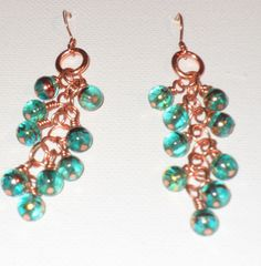 Green Glass Multi Color Red & Gold Beads on Copper by MyPreciousFindings on Etsy https://www.etsy.com/listing/534097420/green-glass-multi-color-red-gold-beads