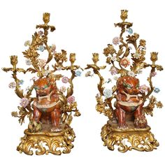 Large Pair of Porcelain and Bronze Figural Candelabras with Foo Dogs | From a unique collection of antique and modern candle holders at https://www.1stdibs.com/furniture/decorative-objects/candle-holders/