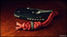 Kershaw Shuffle EDC pocket knife with diamond and crown paracord two-strand lanyard knot, ABoK #784.