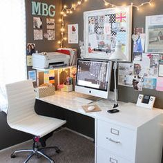 Dorm Room desk area including lighting, an inspiration board, picture frame, and personal touches such as a monogram.