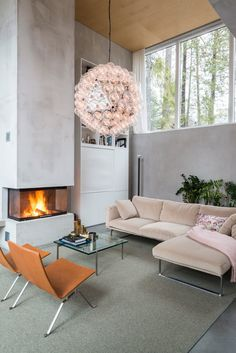 Scandinavian home with the most beautiful ceiling lamp and a cosy fireplace. Cosy Fireplace, Living Room With Fireplace, Living Room Chairs, Living Rooms, Open Kitchen And Living Room, Home Interior Design, Living Room Designs, House Design, Furniture
