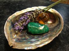 Malachite for earth.  Abalone shell for water.  Lavender for air.  Amber for fire.