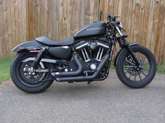A more stock Harley Davidson 883 Iron.