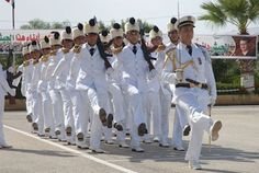 Syrian Navy officers and cadets of the Latakia Naval academy marching through the academy's front square at their 2011 graduation ceremony.