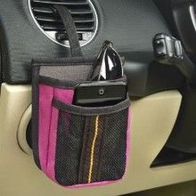 Get organized with this pink car dash pocket organizer. Stash away your sunglasses and other small car essentials. Available at CarDecor.com.