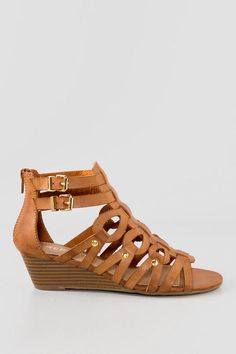 The Midori Demi Wedge Sandal is the go to sandal you need. This sandal has a small demi wedge with an adjustable ankle strap and back zip. The Midori Demi Wedge Sandal have an easy wedge for comfort and can be worn with your favorite dress, jeans or shorts for a variety of looks.