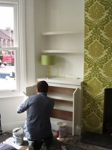 The ordinary way to deal with alcoves on either side of a fireplace is to fill them with shelves or fit a wardrobe or cabinet into the space. If you already have enough storage,. Alcove Desk, Alcove Storage, Alcove Shelving, Alcove Cupboards, Diy Cupboards, Display Shelves, Book Shelves, Alcove Ideas Living Room, Living Room Shelves