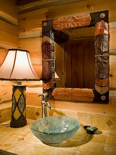 Great idea to repurpose used cowboy boots and add some pizzaz to the bathroom mirror in a - Hunter Interiors.