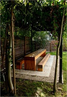 love this long picnic table under a pergola.