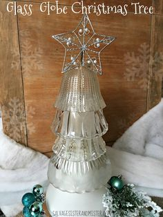 Di do change out a light fixture and have some glass globes around? What about free a free pile or your local thrift store? These are cheap to come by and you can make this easy holiday decor item wit Glass Christmas Tree, Christmas Lights, Vintage Christmas, Christmas Holidays, Merry Christmas, Christmas Decorations, Christmas Ornaments, Snowman Ornaments, Christmas Christmas