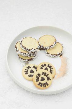 orange hot chocOlate with vanilla cream and stamped orange zest sugar cookies