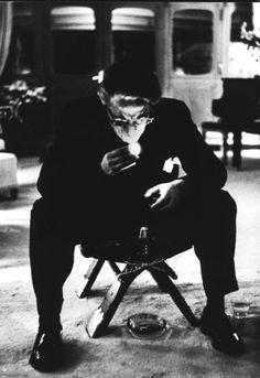 Samuel Beckett lighting up.