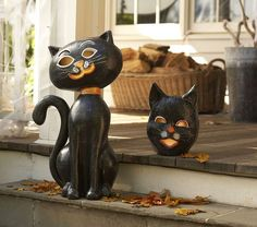 This spooky black cat has a grin that glows from within. Place a flameless candle in the papier mâché design to enjoy a frisky take on the traditional jack-o-lantern. {affiliate link}