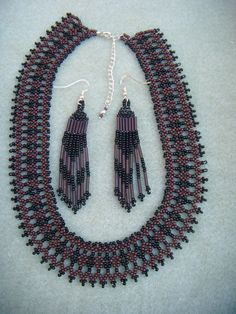 netted necklace that is 14 inches long with a 2 1/2 inch chain extender for a total lenght (with chain extender) 16 1/2 inches long. earrings are 3 1/2 inches long and light weight
