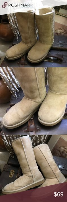 Authentic tall Ugg boots. Tall Ugg Classic boots are loved by all. They are a staple that will never go out of style.color-Sand. Excellent condition. A couple of tiny  spots on toe  but brushing with suede and suede cleaner would take care of that.  Still  in fantastic condition.Tts. UGG Shoes Winter & Rain Boots