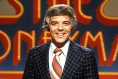 THE MONEYMAZE - 1974-75, Contestants answered questions and then, from their positions overlooking a giant maze, guided their partners through the maze toward a target. Pictured: host Nick Clooney