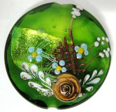 Handmade lampwork bead by Johan de Lange, rose murrini by Sandra Schenck