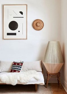 you don't require a lot of art to make a bold decor statement. minimalism can actually speak volumes and draw your eye in immediately. so say perhaps you're on a bit of a budget when it comes to addin