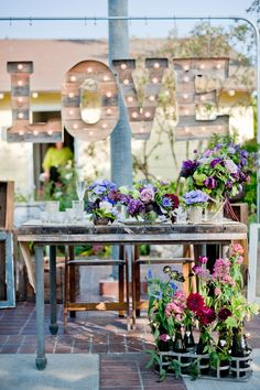 20 Shiny Ways to Incorporate Marquee Lights in Your Wedding Decor via Brit + Co Purple Spring Flowers, Purple Wedding Flowers, Wild Flowers, Wedding Signs, Our Wedding, Dream Wedding, Perfect Wedding, Handmade Wedding, Rustic Wedding