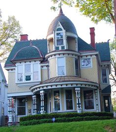 This house in Louisville, KY, has the most wonderful curved front porch and round tower with a real pointy arch in the window.  Paint palette of teal blue with the rich red and soft buttery yellow is nice.