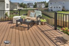 Rather than sand, stain and paint, enjoy a book or conversation curled up on a deck featuring Trex Transcend composite decking in Tiki Torch, Trex Reveal Railing and Trex Outdoor Furniture. Find more inspirational outdoor living spaces at www.Trex.com. #YourNextDeck #sweepstakes #outdoorliving #deck #backyard #patio #porch #outdoorfurniture #deckrailing #compositedeck