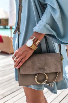 love the powder blue coat grey bag and accessories