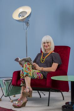 Designer Debra Yearsley relaxes in one of her favourite mid-century pieces. Wall behind is Resene Awash. From habitat magazine, Winter 2014.