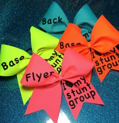 I wonder if we could make something like this? I Heart My Stunt Group Cheer Bow Set by BowPros1 on Etsy, $45.00