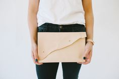   The Laura Clutch   $98.00 - The perfect carry-all for those days when a purse just won't do. The Laura clutch is large enough to hold all of your essentials, from your cell phone, key rings, and day planners, to everything in between.