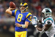 ST. LOUIS - OCTOBER 31: Sam Bradford #8 of the St. Louis Rams looks to pass against Eric Norwood #92 of the Carolina Panthers at the Edward Jones Dome on October 31, 2010 in St. Louis, Missouri.  The Rams beat the Panthers 20-10.  (Photo by Dilip Vishwana