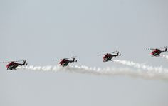 Indian Air Force Sarang Display Team with HAL Dhruv