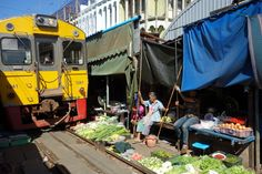 Roughly once an hour a TRAIN passes through the market.