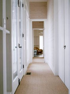 sisal floor covering. plank walls. white trim. black hardware. yes.