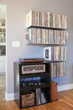Floating record shelves https://www.etsy.com/listing/194859173/floating-vinyl-record-shelves