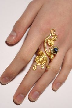 Adjustable gold ring with navy blue crystal stone wire wrapped jewelry handmade wire jewelry. $25.00, via Etsy.