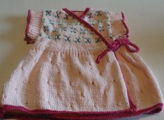 Free Knitting Pattern for pretty babies cross over dress from The Knitting Wool Store- http://www.the-knitting-wool-store.com/baby-dress-pattern.html