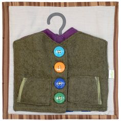 Bundled Up - this wūka square™ has 3 different layers of jackets, one with buttons, one with a zipper, and on with snaps. It will keep you kids entertained for ages and teach them how to get dressed all by themselves. #wuka