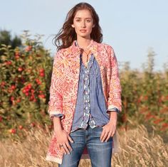 Jacquard-knit with shots of coral and saffron on a heathered oatmeal background, our cardigan works indoors and out.