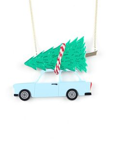 Christmas tree on the car necklace, It is time to pick a Christmas tree, as it is tradition we'll pick it up and choose the most beautiful one, with the most leaves. Now we only need to take it home in our little blue car tied with a Christmassy colored rope.