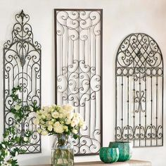 The artistic beauty of wrought iron has captured attention for centuries, and our Gisele Rectangular Iron Wall Artwork is an elegant example of why they intrigue us so    much. Its almost sculpted design and wrought iron-like patterning is reminiscent of 18th century French shutter designs. Note the very    symmetrical styling of this window shutter art. In iron, it gently distressed for an antique appearance. Lightweight, and ready to hang in any    indoor or outdoor space.            In...