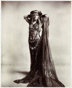 Woman in costume, ca. 1900. This looks like a modern tribal fusion dancer!