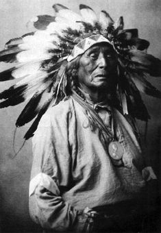 Wanduta (Red Arrow), a Dakota man from the Oak Lake area in Manitoba wearing his treaty medal, circa 1913. Photographed by N. C. Gould, Brandon, Man. Source: National Archives of Canada.
